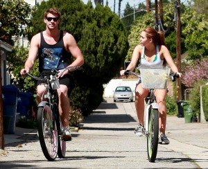 liam-hemsworth-workout-with-miley-bicycling