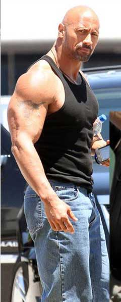 The Rock Workout Arms showing off big muscles in tank top