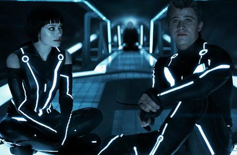 Garrett Hedlund In Tron with Co-Star Olivia Wilde Arms Legs Crossed