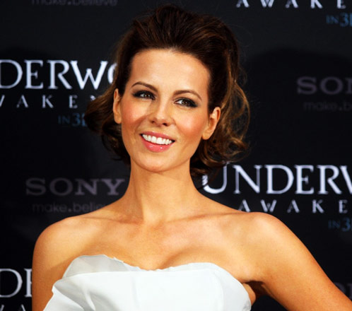 Kate Beckinsale Workout Shoulders Smiling in White Dress