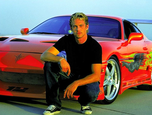 Paul Walker height and weight in front of red car