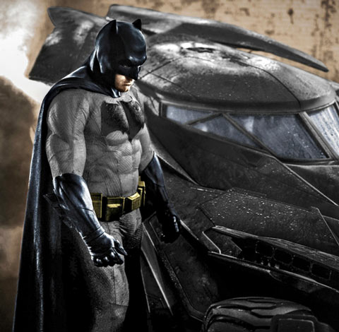 Ben Affleck Batman next to Batmobile