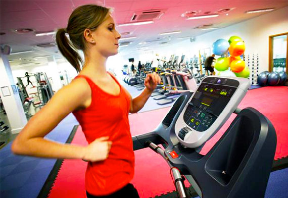 10-30-30 Workout woman training on a treadmill