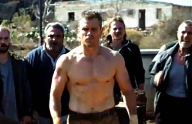 Matt Damon Workout showing off his chest and abs.